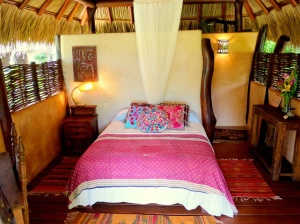 Set in plush gardens with open thatch roofs, here you can drift asleep listening to the ocean waves.